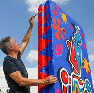 Tim Davies at work on his Berlin Wall painting